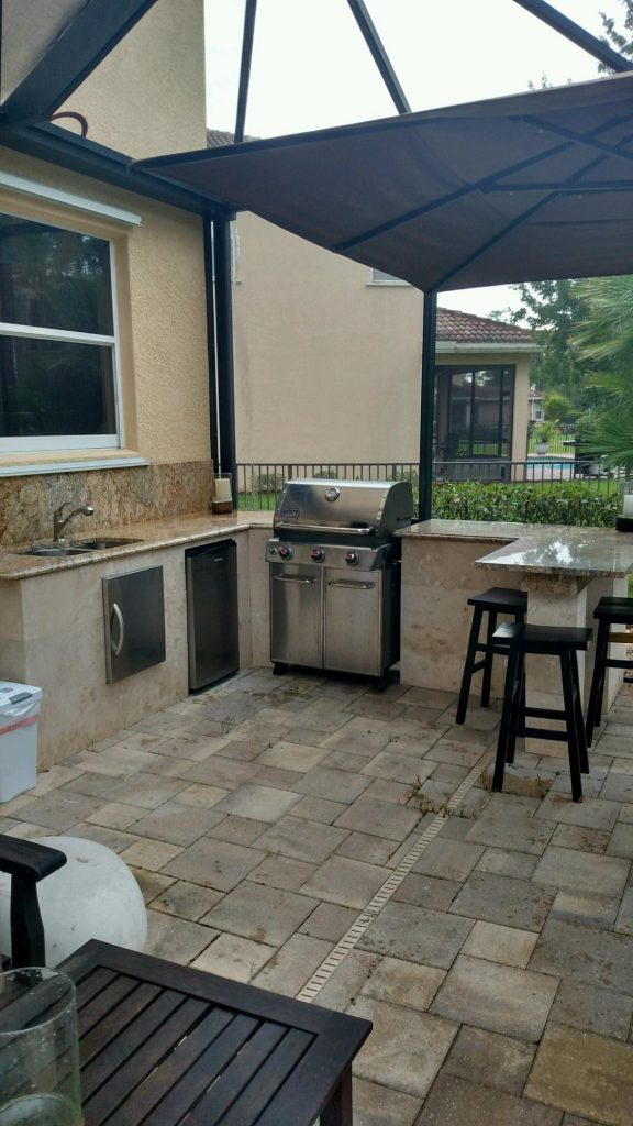 Outdoor kitchen with tile and granite
