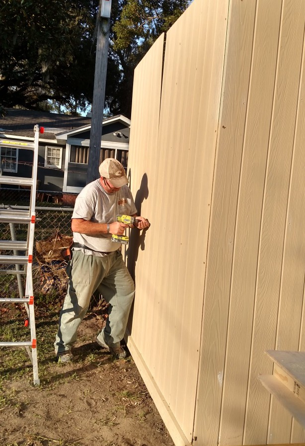 Setting wall of custom backyard shed