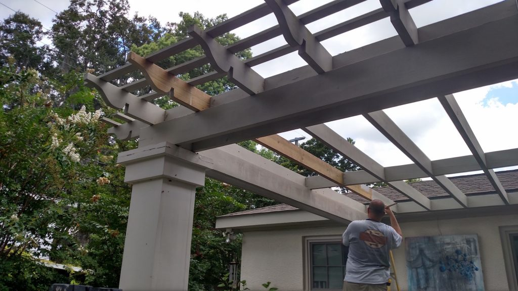 Replaced a rafter to a pergola, matching the cut-out design